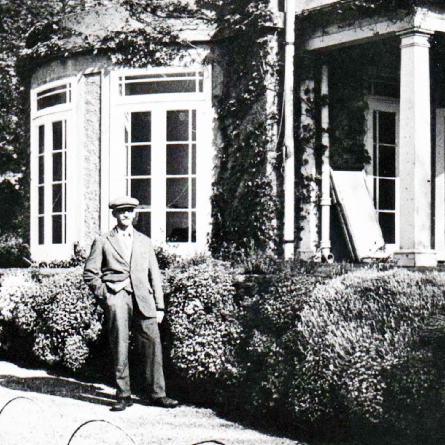 Mr Grace was Caddie Master from 1910 to the 1930's photographed outside the new dining room built in