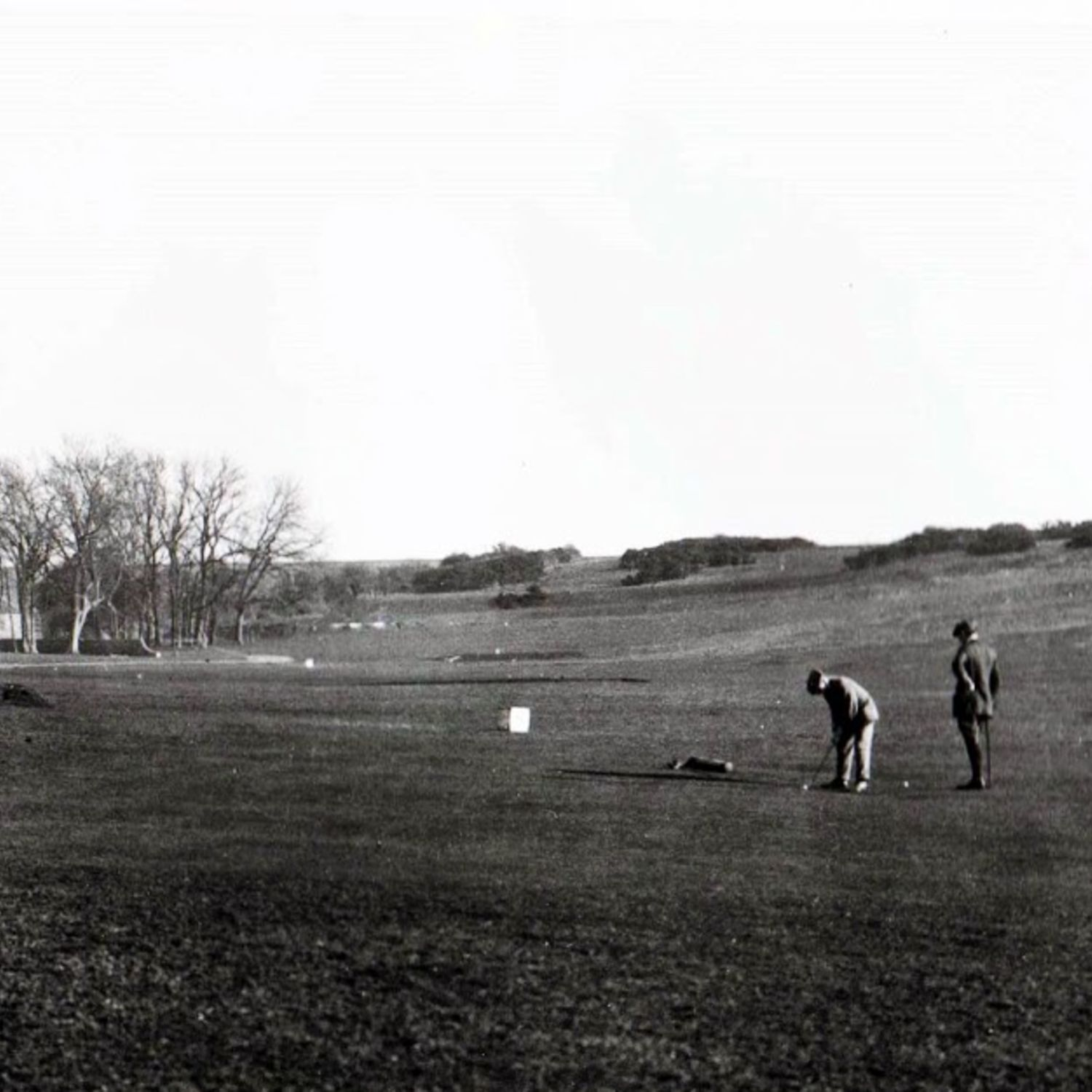 Putting on the nine hole course with the Clubhouse on the left and Broadwater Windmill on the right