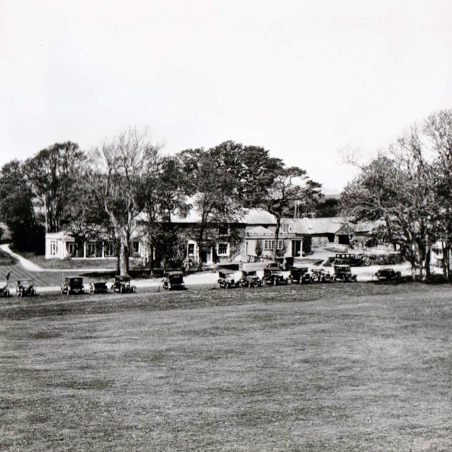 Cars parked on the grass outside the Clubhouse in 1927.