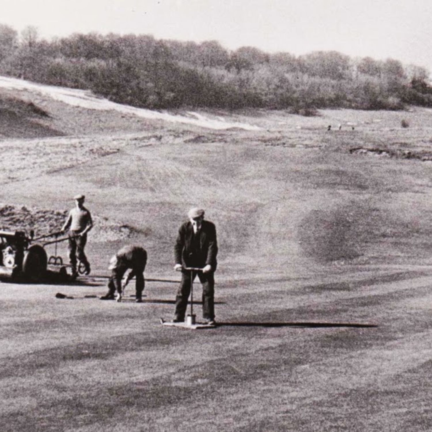 Fred Pratt cutting a new hole on the 12th, while Bill Denyer is working the Ransome overgreen mower.