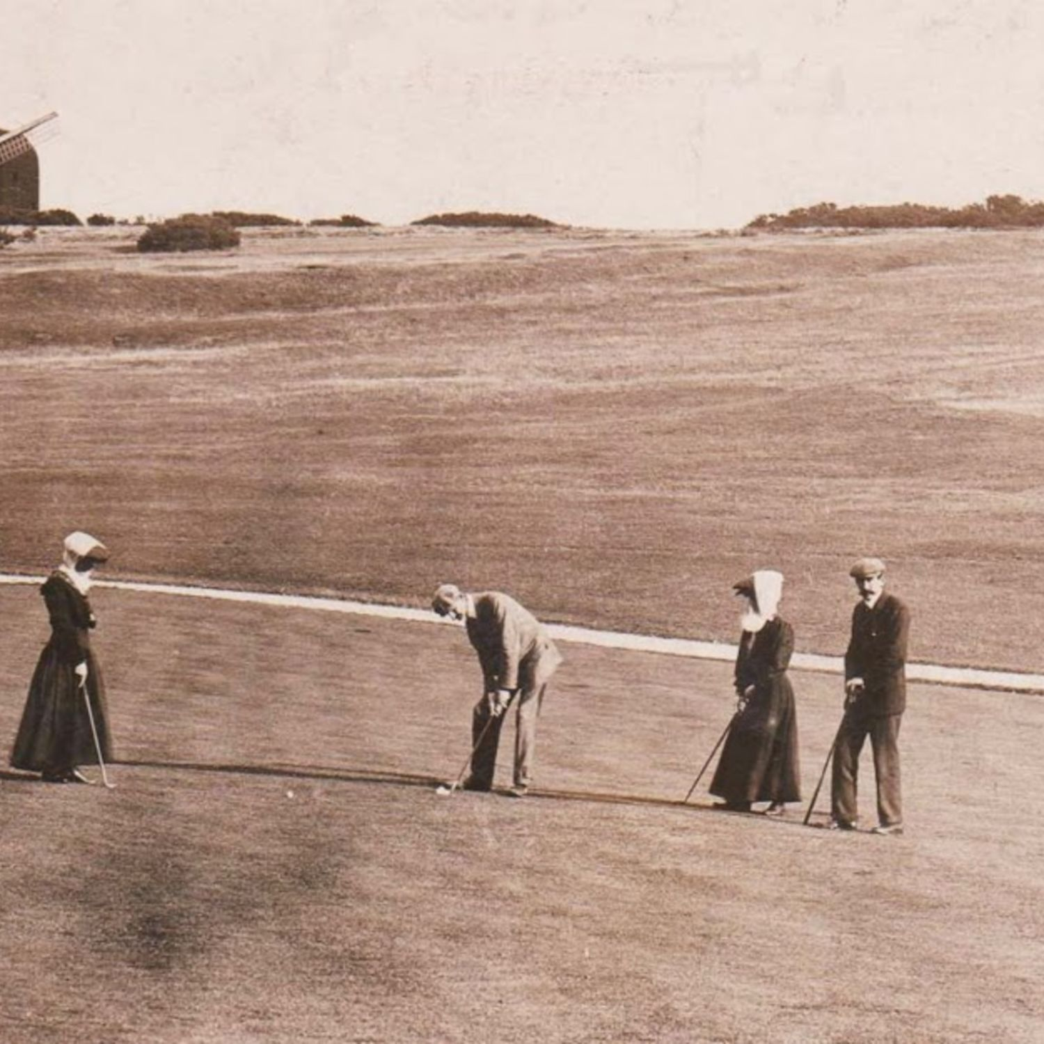 Putting on the nine hole course with the Broadwater Windmill in the background.